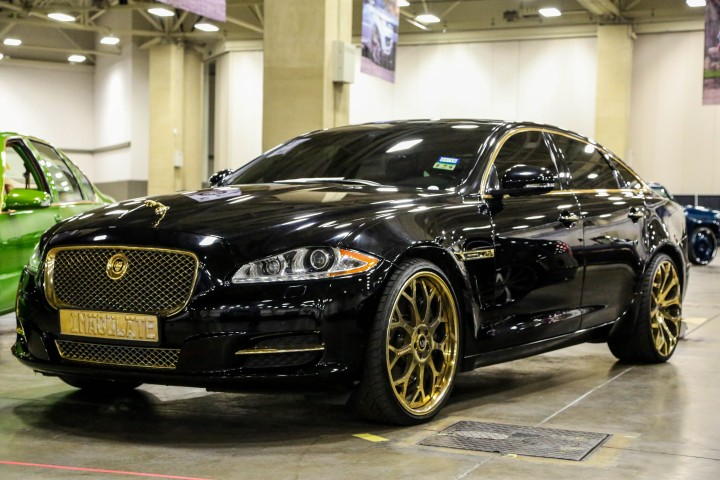 black trimmed in gold jaguar with forgiato wheels big. Black Bedroom Furniture Sets. Home Design Ideas