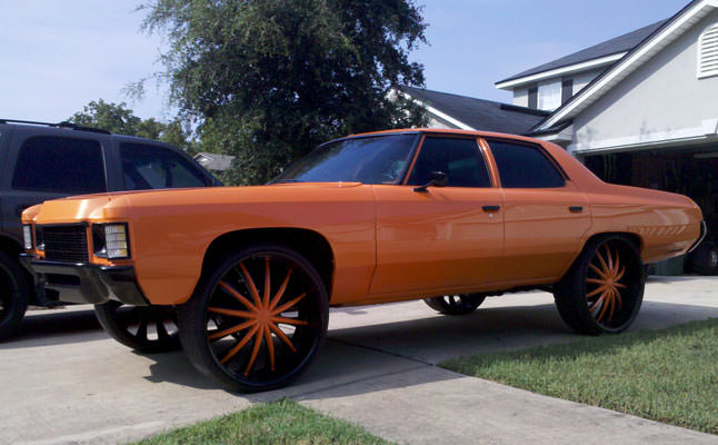 1971 chevrolet impala donk orange - big rims